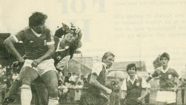 Kris Kalifatidis, Peter Laumets and Oscar Crino clearing the ball from danger against Green Gully at Green Gully Reserve in 1984